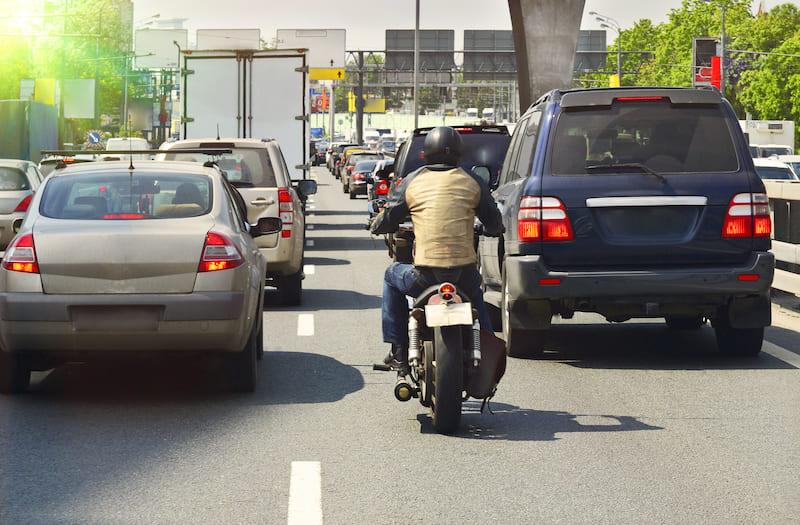 Motorcycle splitting a lane in traffic
