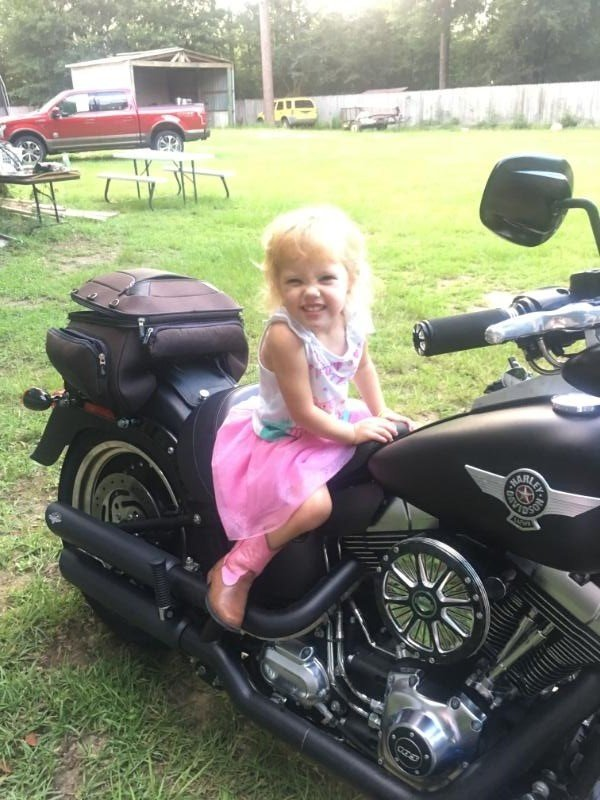 Bailey Hensley gives her mean face on the back of a Harley Davidson motorcycle