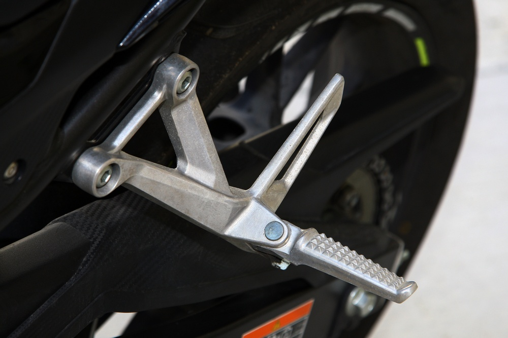 Riding with the rear pegs down is thought to be bad luck