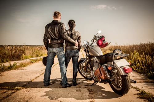 man and women on motorcycle