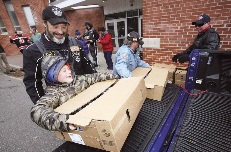 New Jersey Herald shows North Jersey HOG delivers turkeys for needy families.