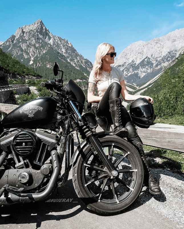 Angie sitting on Harley Davidson Sportster 883R
