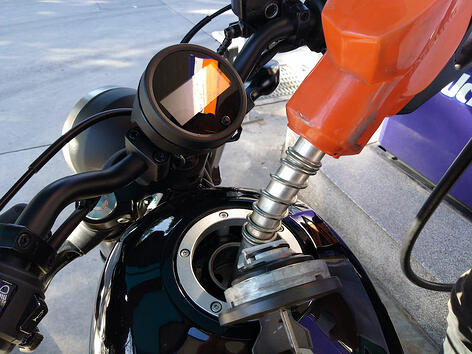 filling up motorcycle