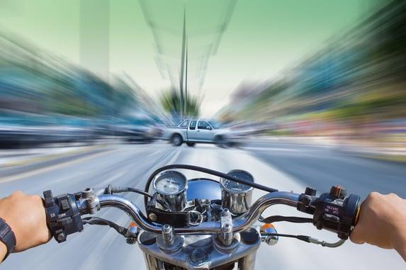 motorcycle heading towards car