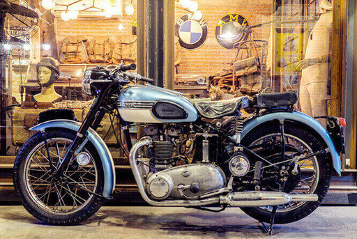 Collector Triumph at a motorcycle exhibition